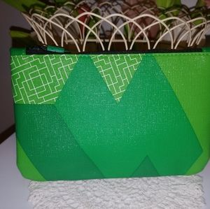 Geometric green makeup clutch